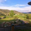 A view from the clubhouse of the putting green at Sonnenalp Golf Club