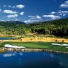 A view over the water of a green at Headwaters Club At Teton Springs