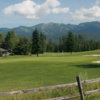 A view of a green protected by a collection of bunkers at Whitefish Lake Golf Club