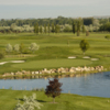 A view of a green with water and bunkers coming into play at BanBury Golf Club