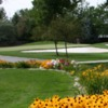 A view of a green surrounded by bunkers at Hillcrest Country Club