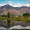 View of the lake and greens at Mulligans Creekside Golf Center