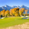 A view of a green protected by bunkers at Jackson Hole Golf & Tennis Club