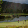 A view of a green with water coming into play at Roaring Fork Club