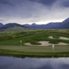 A view of a hole with water and sand traps coming into play at Crested Butte Country Club