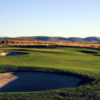A view of a green protected by tricky bunkers at Purple Sage Golf Course