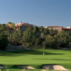 A sunny day view of a green at Las Campanas
