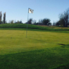 A view of a green at Whispering Winds Golf Club