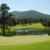 A view of a green with water coming into play at Hiwan Golf Club