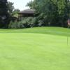 A sunny day view of a green at Colorado Springs Country Club